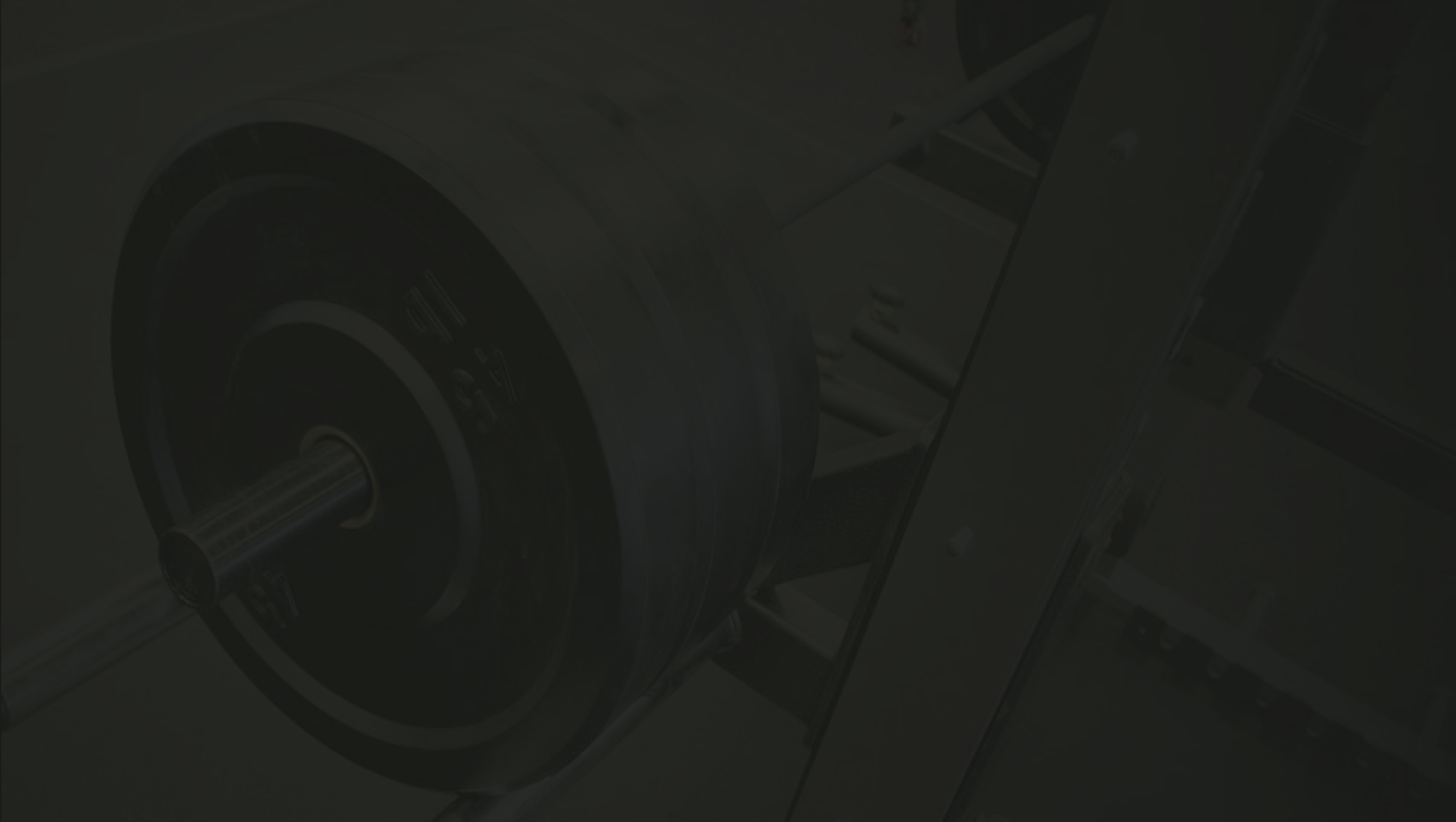 dark grey background with semi transparent pic of chest press weights